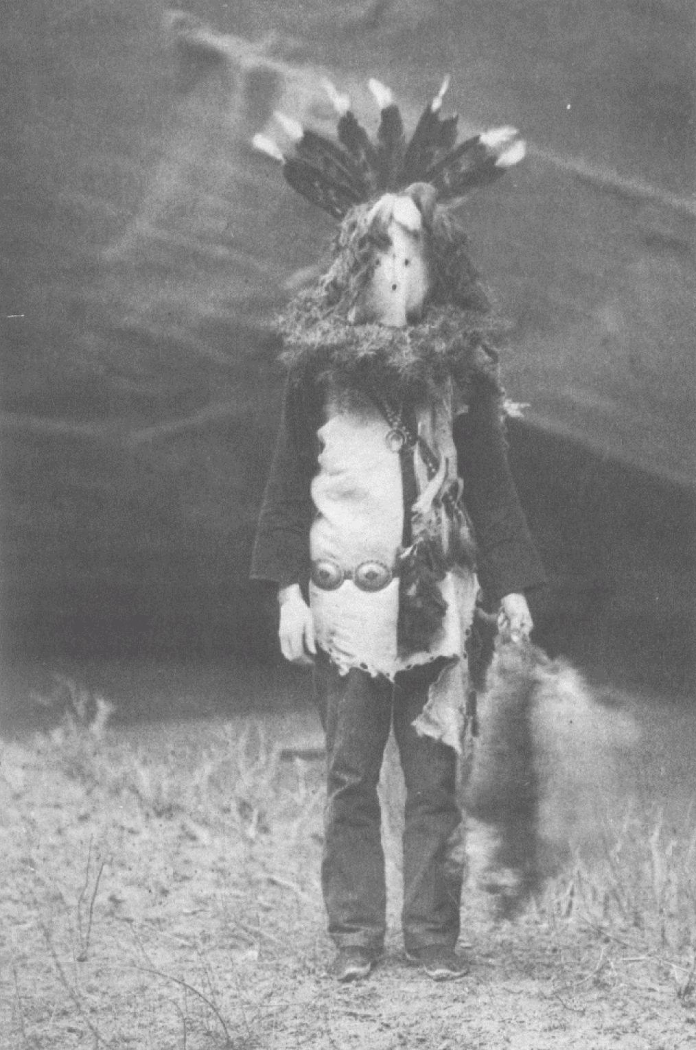 2. Haschélti - Navaho From Copyright Photograph 1904 by E.S. Curtis This, the Talking God, is the chief character in Navaho mythology. In the rites in which personated deities minister to a suffering patient this character invariably leads, carrying a fou