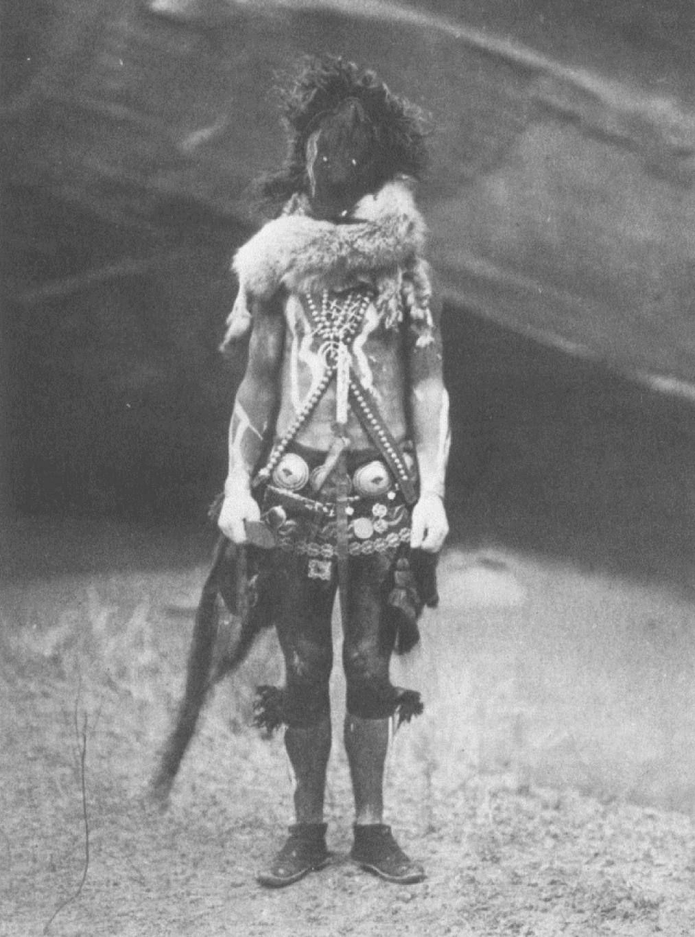 4. Nayénezgani - Navaho From Copyright Photograph 1904 by E.S. Curtis Two of the most important characters in Navaho mythology are twin miracle-performing sons of White-Shell Woman, Yólkai Estsán, chief goddess. This plate pictures the leader of the two—t