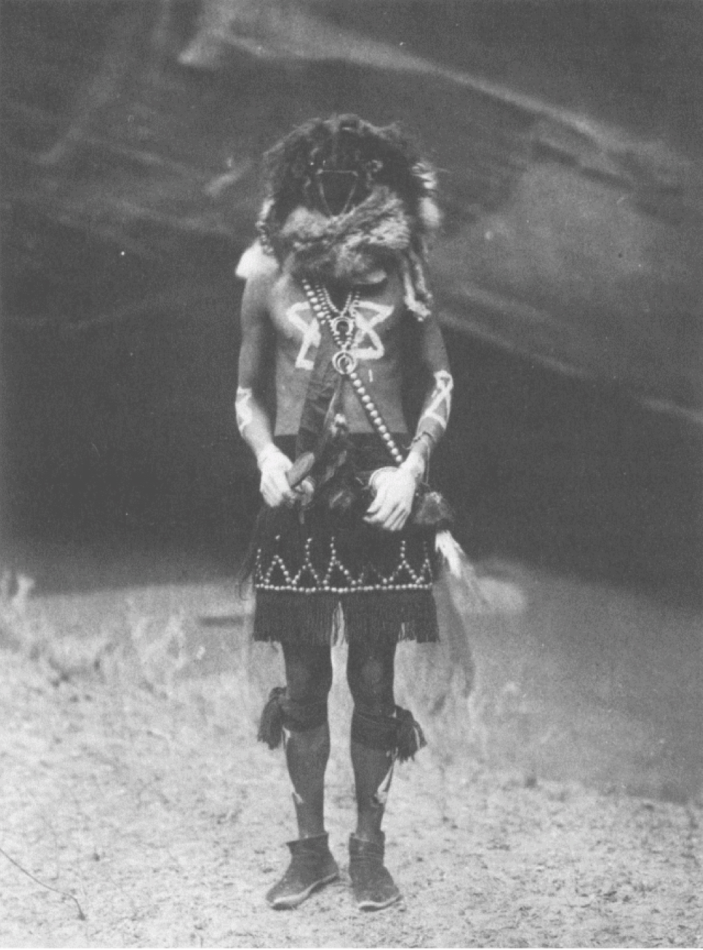 5. Tobadzischíini - Navaho From Copyright Photograph 1904 by E.S. Curtis This is Born From Water, the second of the twin miracle-performing sons of Yólkai Estsán, the White-Shell Woman. His brother is Nayénezgani.