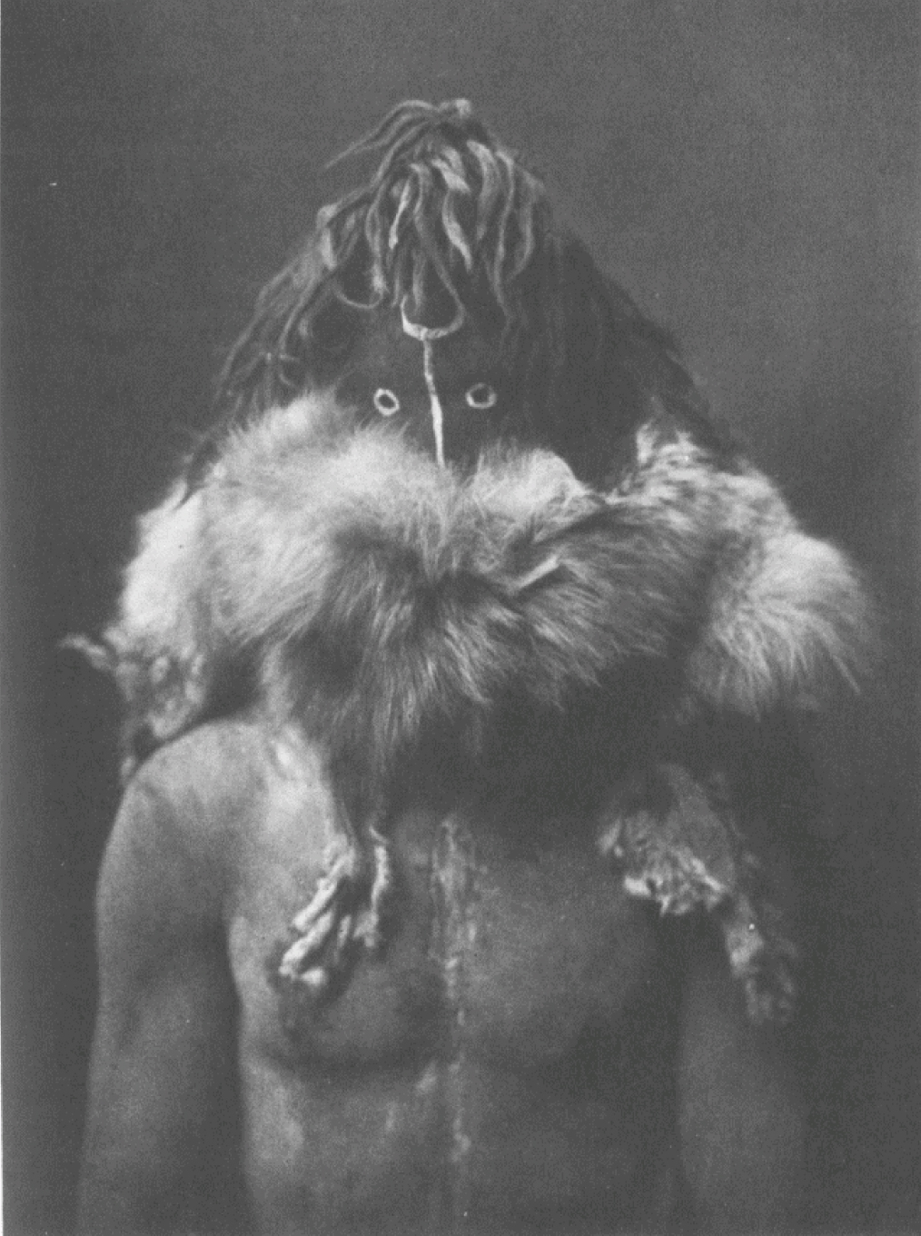 6. Haschézhini - Navaho From Copyright Photograph 1904 by E.S. Curtis Black God, the God of Fire. An important deity of the Navaho, but appearing infrequently in their mythology and ceremonies.