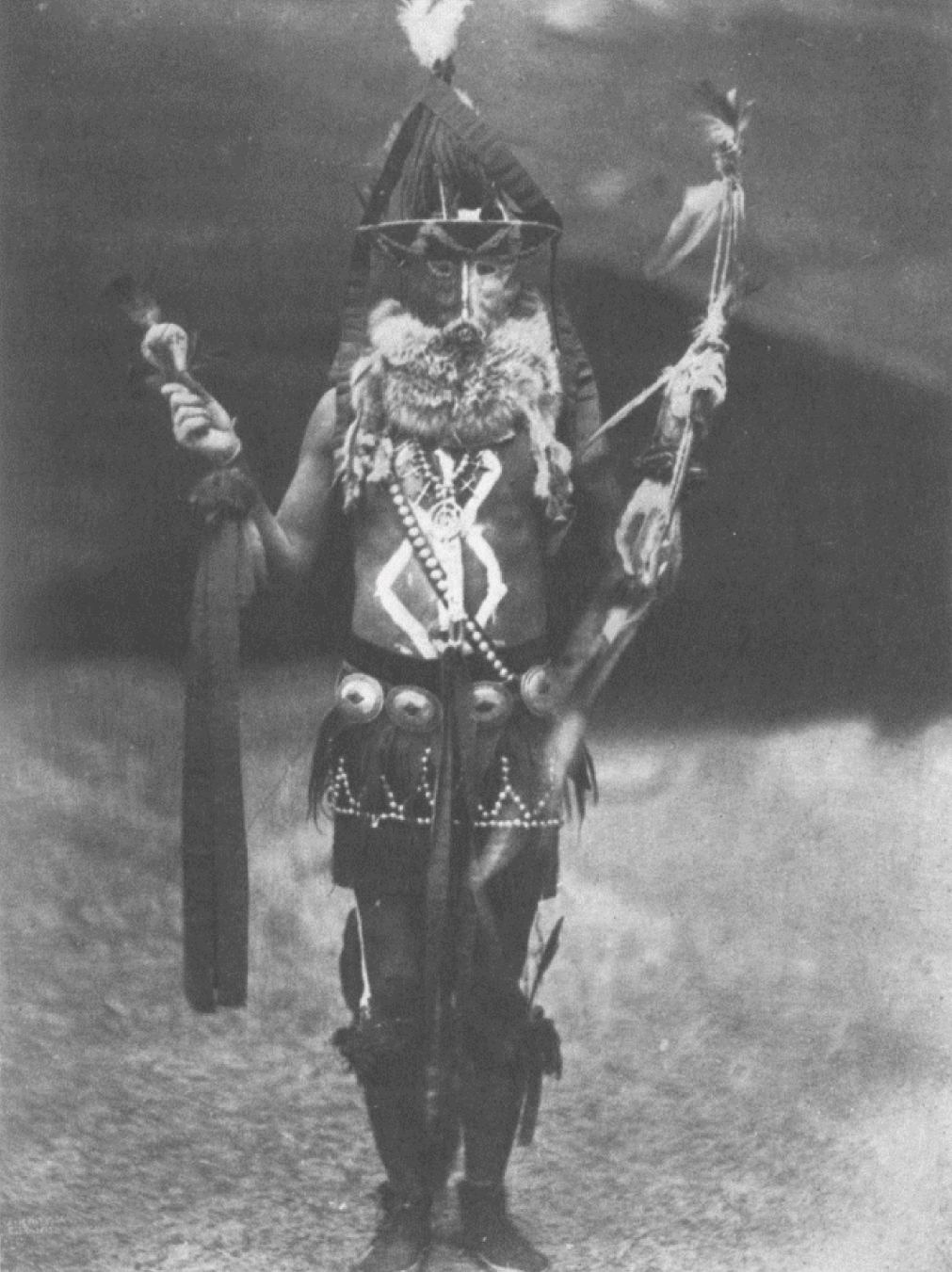 "9. Zahadolzhá - Navaho From Copyright Photograph 1904 by E.S. Curtis These deific characters in Navaho mythology, though beneficent always, have no special functions to perform. The name means ""Fringe Mouth"" and has no ascertainable significance other tha"