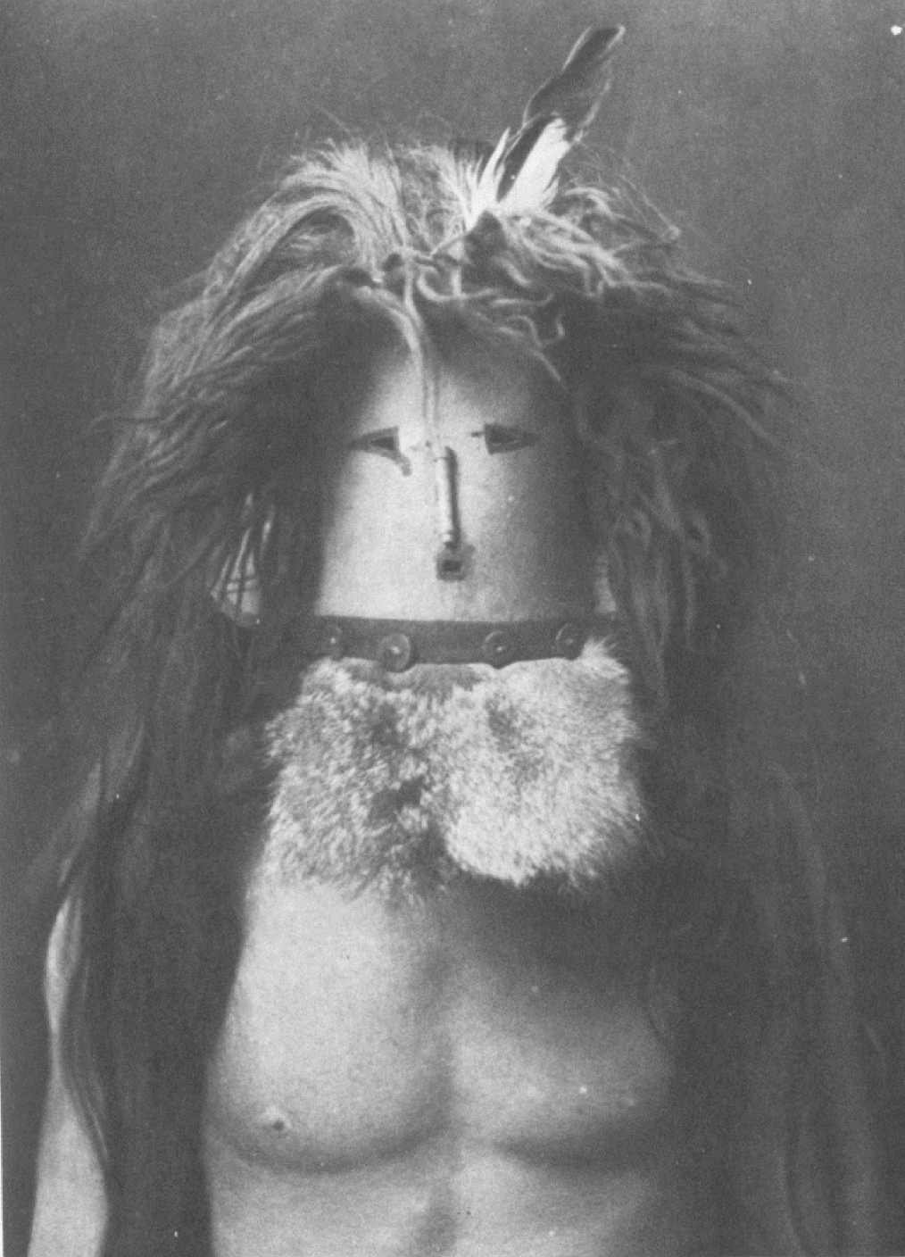 10. Haschebaád - Navaho From Copyright Photograph 1904 by E.S. Curtis In Navaho mythology there are numerous references to benevolent female deities, who are personated in medicine rites by men wearing masks, as shown in this plate. Haschebaád may be tran